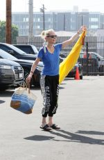 Anne Heche Twirls her yellow dress as she poses up for the cameras in Los Angeles