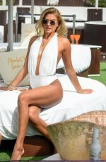 Arabella Chi Showcases her incredible figure when pictured on a photoshoot in Ibiza