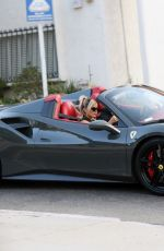 Bebe Rexha Confirms Her New Relationship With a Kiss as She Gets a New Ferrari Delivered to Her Home in Los Angeles