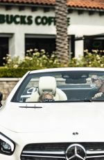 Britney Spears Appears a bit disheveled and wears her cat mask upside down while cruising in Calabasas