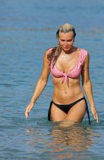 Caprice Bourret Display her incredible bikini body as she relaxes at the beach while on holiday in Ibiza