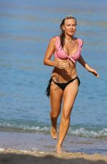 Caprice Bourret Shows off her incredible bikini body as she relaxes at the beach while on holiday in Ibiza