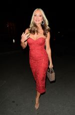 Caprice Wears stunning red strapless lacy dress as she enjoys a rare night out at Mecca Bingo Live in London