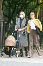 Chloe Sevigny Shows off her style as she steps out for a walk with her baby and a friend in New York