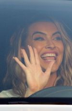 Chrishell Stause All smiles as she exits the DWTS studio in Los Angeles