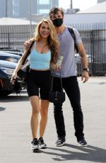 Chrishell Stause Looks lovely in a blue top and biker shorts as she heads to the DWTS studio in Los Angeles