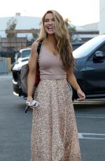 Chrishell Stause Poses in an animal print dress as she head into the DWTS studio in Los Angeles