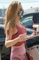 Chrishell Stause Puts her slim figure on display with purple ensemble as she arrives at the DWTS studio in Los Angeles