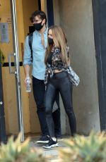 Chrishell Stause Smiles to fans as she heads out with Gleb Savchenko after their dance practice in Los Angeles