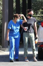 Courteney Cox Is walked to her car by a nurse after visiting a doctor