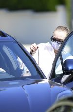Dakota Fanning Learns to drive in her new Porsche SUV in Los Angeles