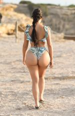 Demi Rose Flaunts her curves on the beach in Ibiza, Spain