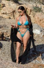 Demi Rose Grabs a healthy smoothie while out on the beach in Ibiza, Spain