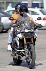 Diane Kruger And Norman Reedus riding a motorcycle in Malibu