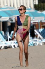 Diane Kruger In a one piece bathing suit while walking on the beach in Los Angeles