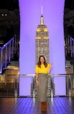 Drew Barrymore by lighting the Empire State Building in Midtown Manhattan