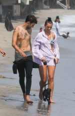 Dua Lipa Walks her new puppy with her boyfriend and friends along the shores of Malibu