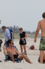 Emily Ratajkowski Relaxes on the beach with husband Sebastian and friends in The Hamptons