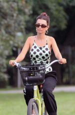 Emily Ratajkowski Riding her bike in The Hamptons after spending the day at the beach