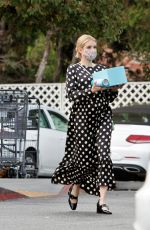 Emma Roberts Shows her growing baby bump while out shopping in Los Angeles