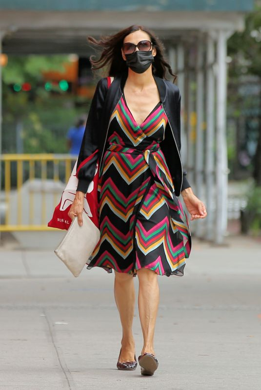 Famke Janssen Seen walking home in a colorful dress in Soho