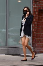 Famke Janssen Turns heads in white mini dress as she takes a stroll in New York