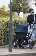 Felicity Jones Is seen for the first time since giving birth as she takes her newborn for a stroll in London