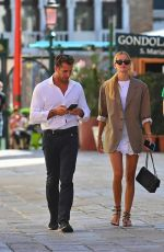 Frida Aasen Strolling hand in hand with enterprainer Tommy Chiabra in Venice