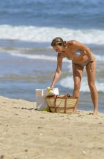 Gwyneth Paltrow Shows off her toned beach body as she cools off with a swim in the ocean in The Hamptons