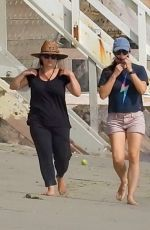 Jennifer Garner In shorts walking on the beach in Malibu