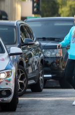 JoJo Siwa Grabs an iced coffee while shopping with a friend in Los Angeles