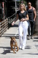 Josie Canseco Is all smiles as she enjoys a fun lunch with a bunch of pals and her cute pooch in Los Angeles
