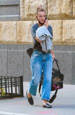 Kaley Cuoco On her phone in NYC
