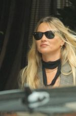 Kate Moss Goes incognito wearing a protective face mask although her name in big letters in London