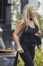 Kate Moss Looking fresh faced as she enjoyed a lunch date with friends out in London