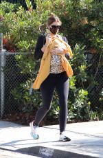Katherine Schwarzenegger Cradles one-month-old baby Lyla during a stroll in Brentwood