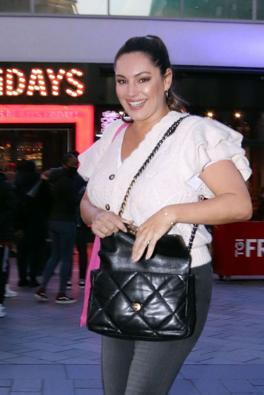 Kelly Brook Is all smiles as she pictured leaving the Global studios after hosting her radio show in London