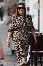 Kelly Brook Looks stunning in a tiger print dress at the Heart Radio Studios in London