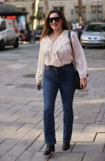 Kelly Brook Pictured at Heart radio in tight denim and blouse in London