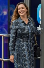 Kelly Brook Pictured at the Heart Radio Studios in a snakeskin patterned flattering dress in London