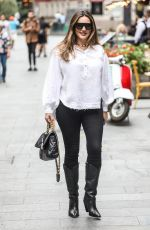 Kelly Brook Pictured looking stylish in white blouse and black trousers in London