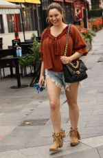Kelly Brook Seen arriving at Global Studios for Heart Radio in London wearing ripped denim shorts along with Chanel bag in London