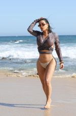 Kim Kardashian Looking hot and puts on a sultry display while walking down the beach in Malibu