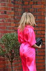 Kylie Minogue Looking sensational in an electric pink silk outfit as she arrived to a dinner party in South London