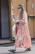 Lacey Turner Looks summery in her long dress pictured in London