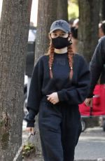 Madelaine Petsch Takes her dog Olive out for a walk as she returns to Vancouver for
