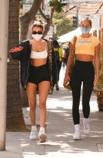 Madison Beer Puts on a leggy display as she enjoys lunch before doing some shopping with a friend in Beverly Hills