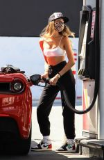 Madison Beer Sizzles at the pump while fueling up her Ferrari inn Los Angeles