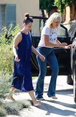 Malin Akerman Cuts a casual figure in jeans and a white tee while out visiting a friend in Los Feliz