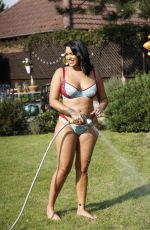 Malin Andersson Strips off down to her bikini to enjoy one of the hottest days in September and enjoys cooling off with a hosepipe